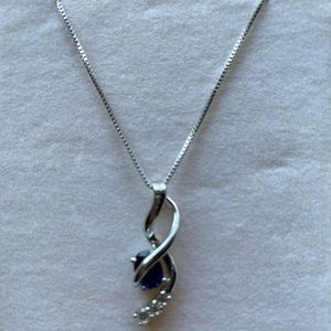 Kay jewelry's silver necklace with blue stone